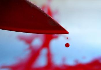 Bloody knife with blood drops