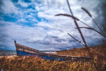 Blue Canoe Under the Blue Sky