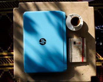 Blue Hp Laptop Near Notebook