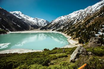 Blue Lake Surrounded by White Snowcapped Mountain