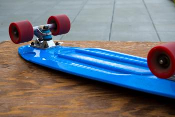 Blue Penny Board on Wooden Table