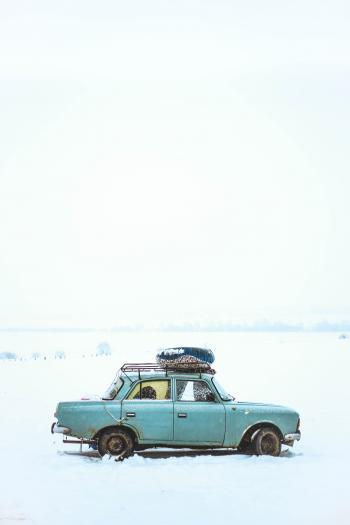 Blue Sedan on Snow