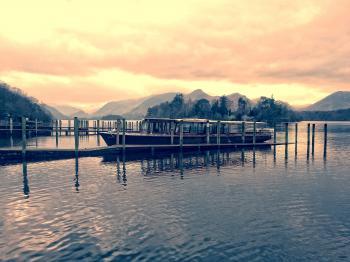 Boat Beside Dock during Golden Hour