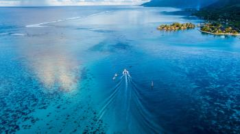 Boat Sailing Towards With Blue Calm Body of Water