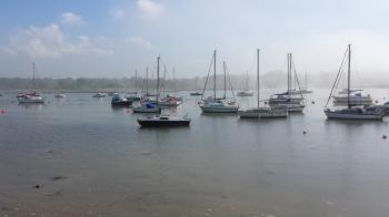Boats in the mist on the hamble river