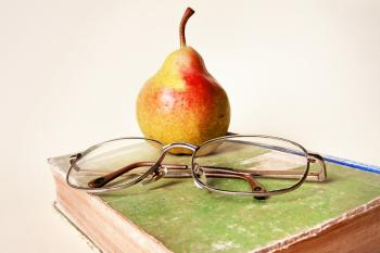 book, glasses and pear
