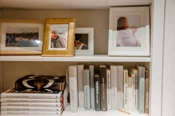 Bookshelves with books and photo frames
