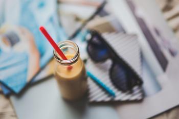 Bottle with yellow yogurt