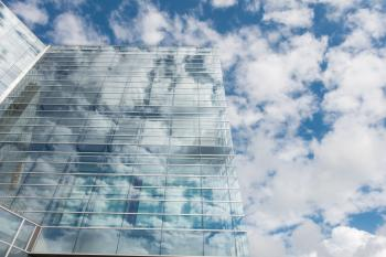 Bottom View of Clear Glass Building Under Blue Cloudy Sky during Day Time