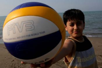 Boy holding a volleyball