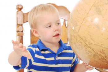Boy learning georgraphy