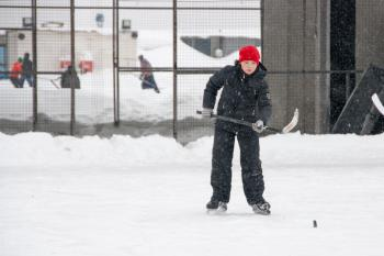 boy playing ice hockey