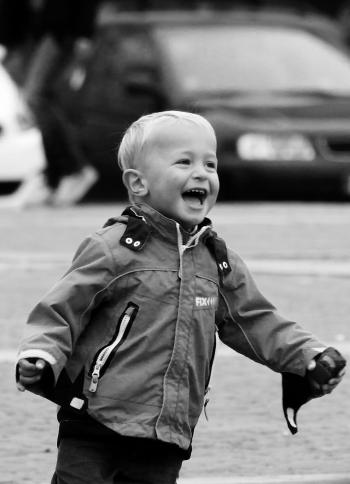 Boy Wearing Jacket on Street in Grayscale Photography