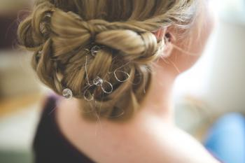 Bride's hair, styled with a hair ornament