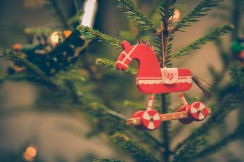 Brown and Red Horse Decor Hanged on Christmas Tree