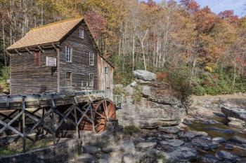 Brown Cabin Under Water Wheel