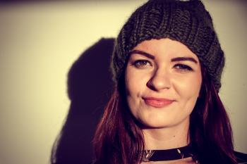 Brown Haired Woman Wearing Black Knitted Hat