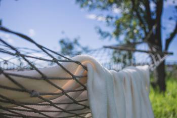 Brown Hammock With Towel Near Trees