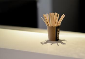 Brown Popsicle Sticks in Brown Disposable Cup
