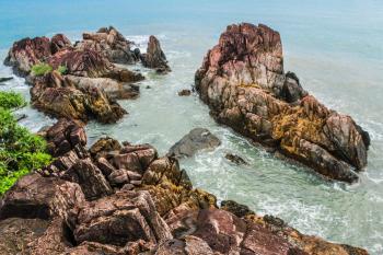 Brown Rock Formations Beside Ocean