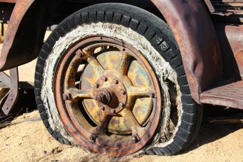 Brown Spoke Car Wheel in Brown Sand during Daytime