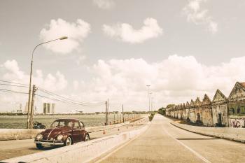 Brown Volkswagen Beetle on Asphalt Road