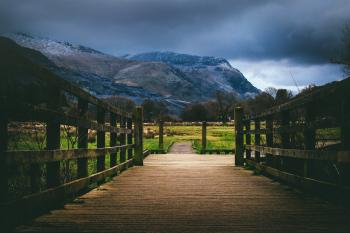 Brown Wooden Bridge Near Mountain at Daytime