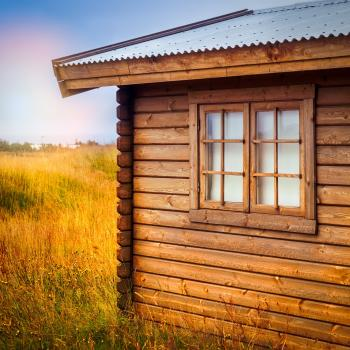 Brown Wooden Cottage at the Field during Day