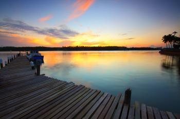 Brown Wooden Dock on Body of Water during Twilight