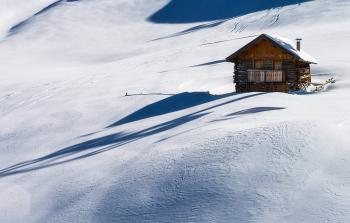 Brown Wooden House on Snow