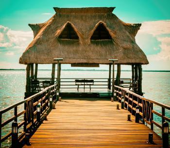 Brown Wooden Hut On Pier