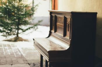 Brown Wooden Upright Piano in Shallow Focus Lens
