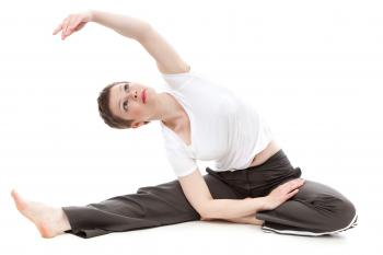 Brunette Short Haired Woman Stretching Arm Overhead in Yoga Pose