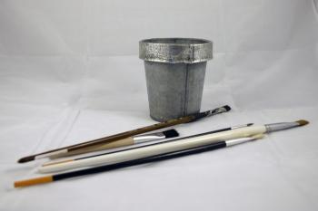 Brushes and a tin can