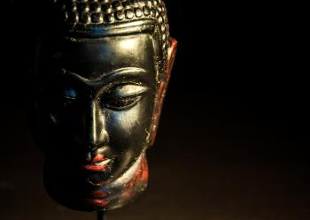Buddha statue dark background