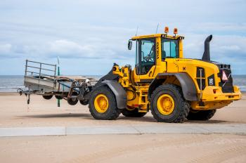 Bulldozer tractor working on a beach