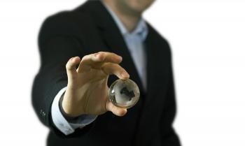 Businessman and crystal globe
