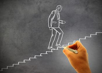 Businessman climbing staircase - Concept of climbing the career ladder