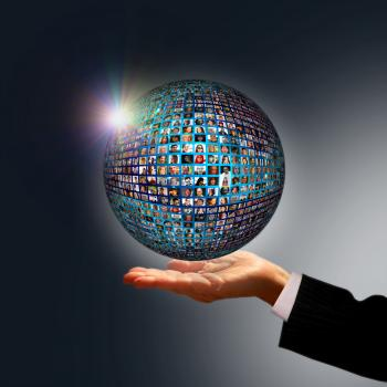 Businessman holding a globe made of people