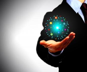 Businessman holding a globe with information technology icons