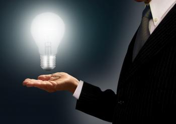 Businessman holding a lightbulb - Ideas and creativity concept