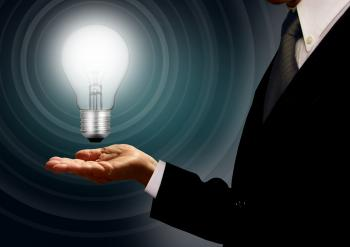Businessman holding a lightbulb
