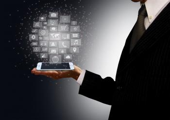 Businessman holding a smartphone with information technology holograph