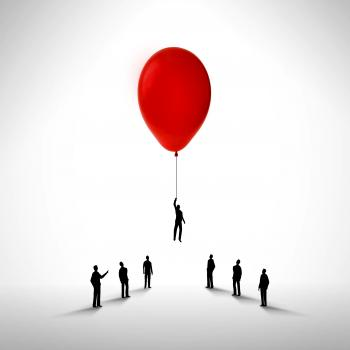 Businessman rising by holding a balloon