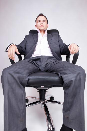 Businessman Sitting in Chair
