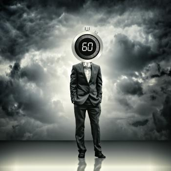 Businessman with stopwatch head - Time concept