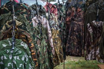 Camouflage clothes stand