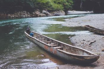 Canoe on Muddy Riverbank