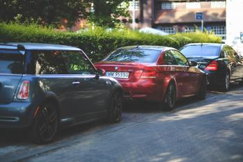 Cars parked along way