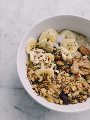 Cereal With Banana on White Bowl